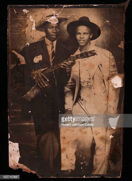 Legendary American blues singersongwriter and guitarist Robert Johnson left with fellow blues musician Johnny Shines circa 1935 This image is one of...