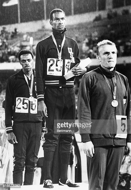 American Bob Beamon stands on the victory stand after winning the long jump competition with a world-record jump at the 1968 Summer Olympics....