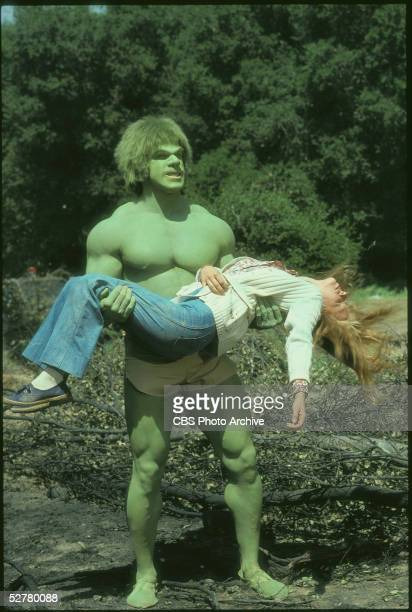 American bodybuilder and actor Lou Ferrigno holds American actress Laurie Prange who lies unconscious in his arms in a television still from the...