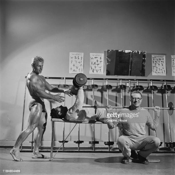 American bodybuilder Jack Delinger winner of the Mr Universe 1956 contest in a gymnasium 1956