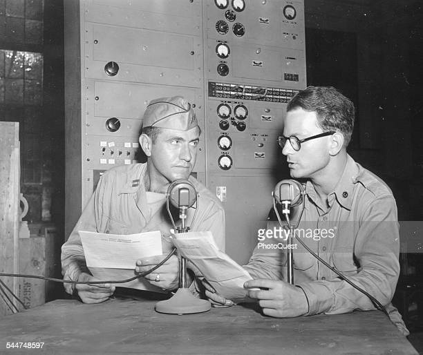 American bombadier Captain Louis Zamperini speaks to NBC and Reuters correspondent Joe Laitin at a Radio Corporation of America station, September...