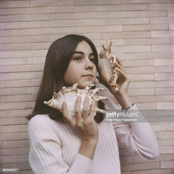 American born actress and singer Romina Power pictured holding two large sea shells to her ears circa 1965 Romina Power is the daughter of the actors...
