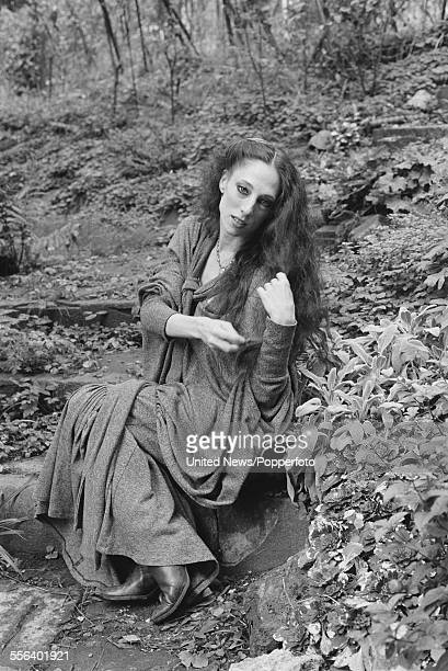 American born ballet dancer, Naomi Sorkin pictured sitting on steps in a woodland setting in England on 26th October 1983.