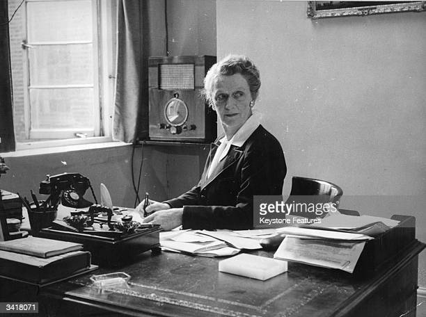 American born British political and social leader Lady Astor at work in her London office