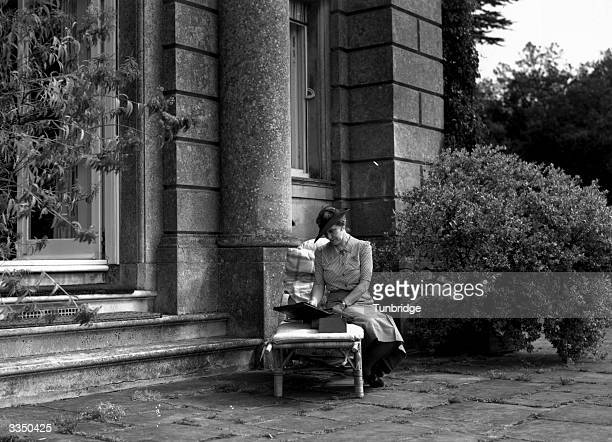 American born British politician, Nancy Astor, Viscountess Astor , at her home at Cliveden in Buckinghamshire. Nancy Astor was the first woman to...