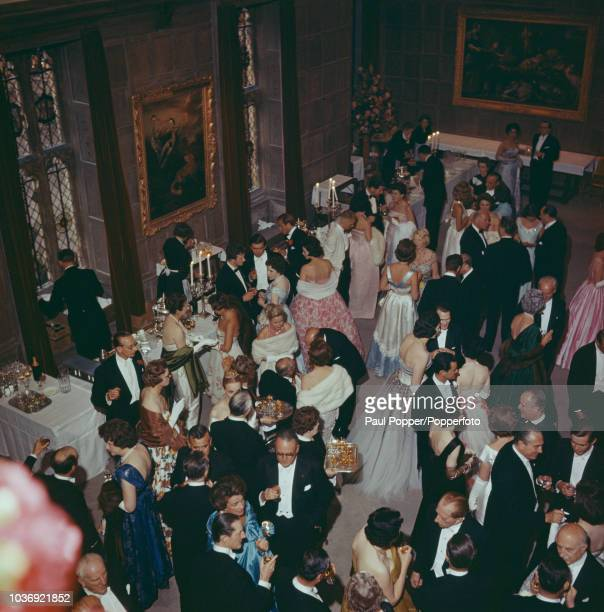 American born industrialist J Paul Getty among his guests at a party at his recently acquired Sutton Place manor house near Guildford Surrey 7th July...