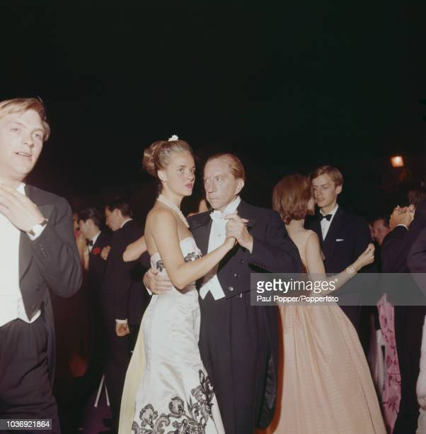 American born industrialist J Paul Getty dancing with French model Madelle Hegeler at a party at his recently acquired Sutton Place manor house near...