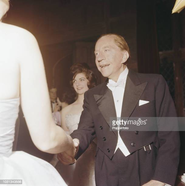 American born industrialist J Paul Getty founder of the Getty Oil Company pictured greeting guests arriving for a party at his recently acquired...
