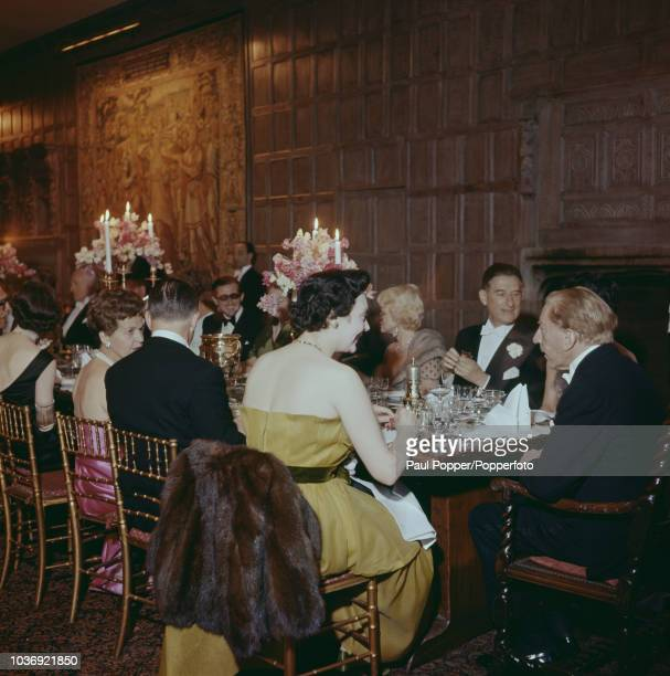 American born industrialist J Paul Getty with his guests at a party at his recently acquired Sutton Place manor house near Guildford Surrey 7th July...