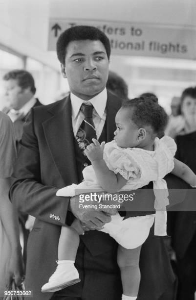 American boxer and activist Muhammad Ali with his daughter Hana at Heathrow Airport London UK 14th July 1977