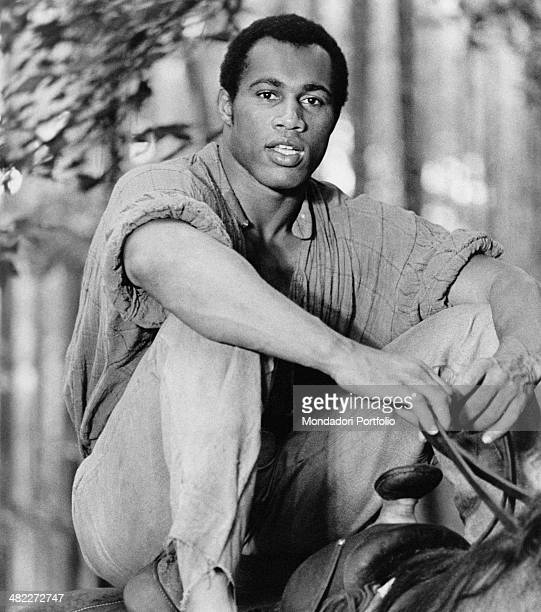 American boxer and actor Ken Norton in the saddle of a horse acting in the film Mandingo 1975
