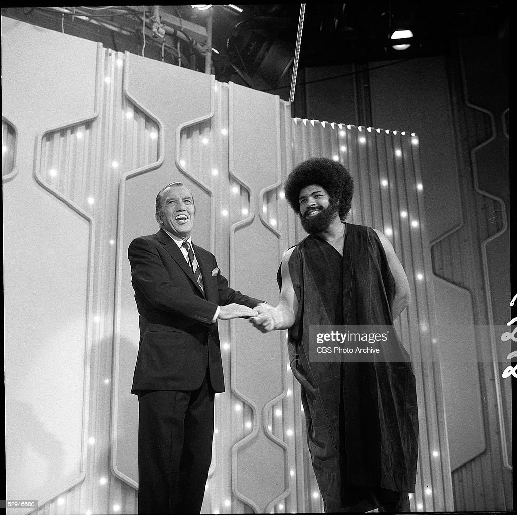 American boxer and sometime actor Muhammad Ali shakes hands with American television empresario Ed Sullivan (1902 - 1974) on an episode of Sullivan's 'Toast of the Town,' New York, January 18, 1970. Ali has just performed an excerpt from 'Buck White' a Broadway musical in which he starred.