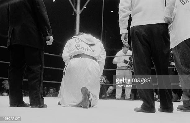 American boxer Carmen Basilio in the ring during his World Middleweight title rematch against Sugar Ray Robinson at Chicago Stadium 25th March 1958...
