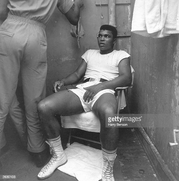 American boxer Cassius Clay rests during training for the world heavyweight title fight against fellow American Sonny Liston at Miami Beach Florida...