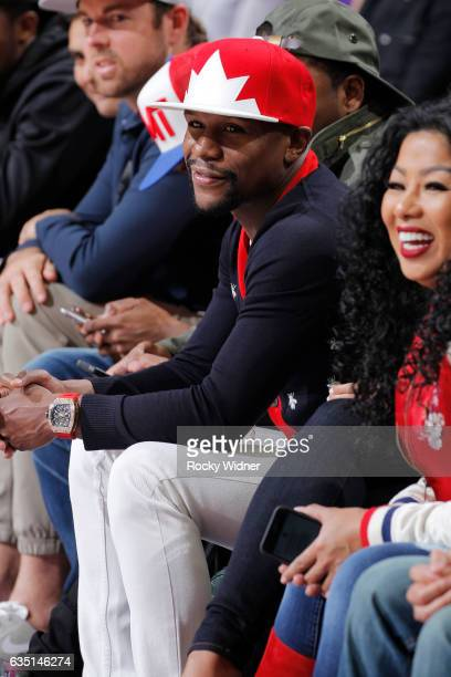 American boxer Floyd Mayweather looks on during the game between the Boston Celtics and Sacramento Kings on February 8 2017 at Golden 1 Center in...