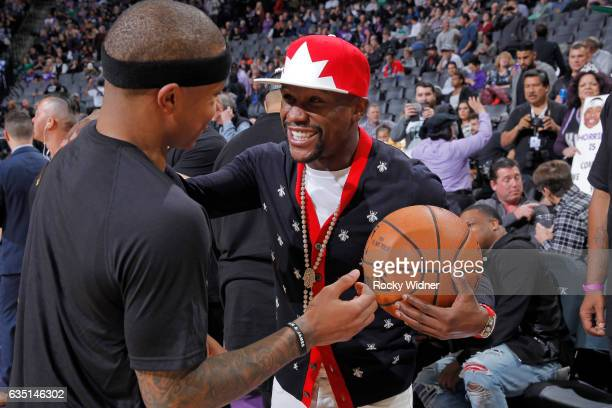 American boxer Floyd Mayweather talks with Isaiah Thomas of the Boston Celtics after the game against the Sacramento Kings on February 8 2017 at...
