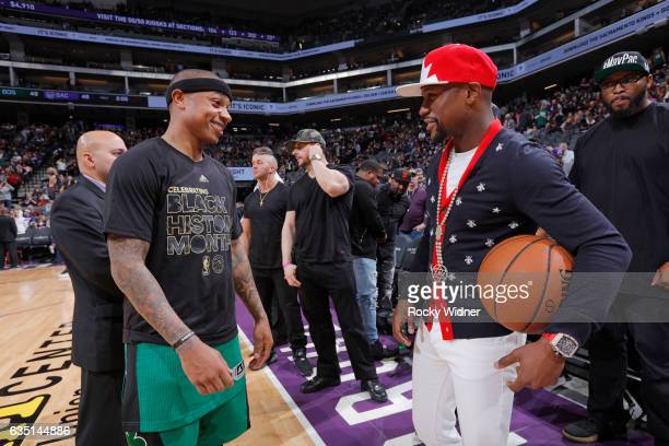 American boxer Floyd Mayweather talks with Isaiah Thomas of the Boston Celtics prior to the game against the Sacramento Kings on February 8 2017 at...