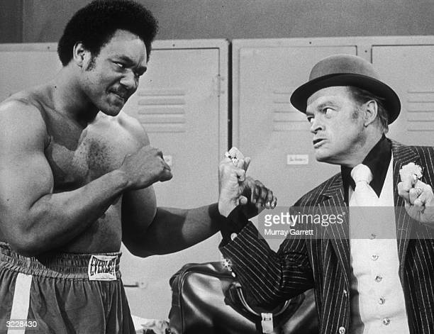 American boxer George Foreman and British-born actor and comedian Bob Hope square off in a still from one of Hope's television specials.