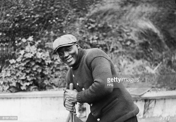 American boxer Jack Johnson the world heavyweight champion grips an unidentified apparatus San Francisco California early 1910s