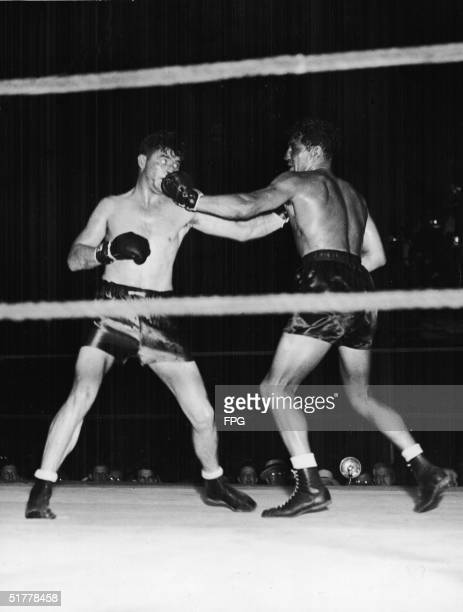 American boxer James Braddock and defending heavyweight champion American boxer Max Baer trade blows during a title bout Long Island City New York...