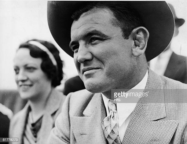 American boxer James Braddock and his wife Mae smile as they watch a exhibition arranged by New York State Troopers Sidney New York June 4 1935...