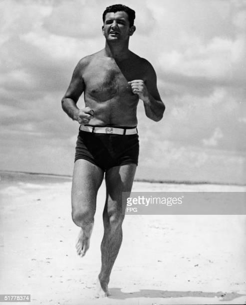 American boxer James Braddock runs along a beach as he trains Florida 1936 Braddock became the defending heavyweight champion after winning the title...