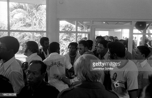 American boxer Joe Frazier and his cornermen and staff arrive at the Folk Arts Center for a public training session in the Folk Arts Center Manila...