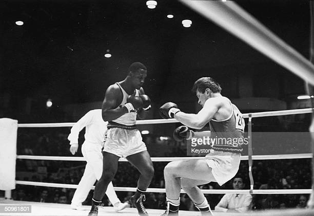 American boxer Joe Frazier fells his Soviet opponent Vadim Yemelyanov in the Olympic Super Heavyweight Boxing semifinal at the Korakuen Ice Palace...