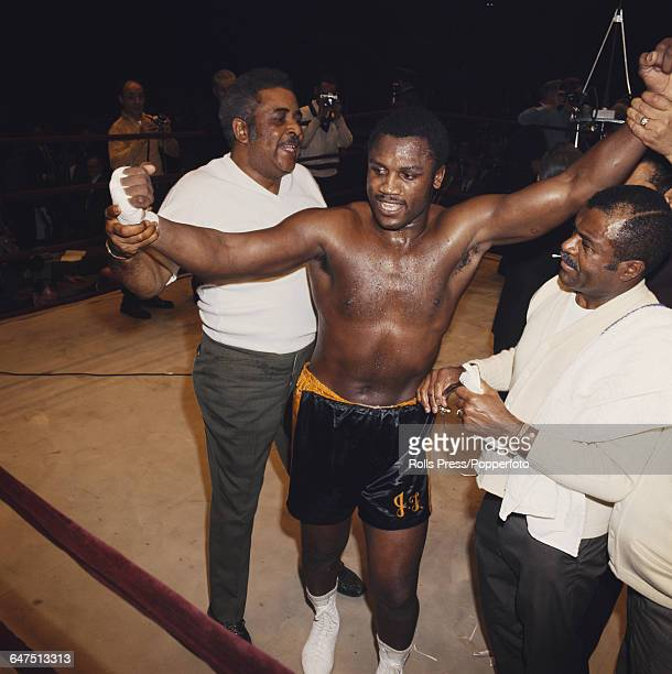 American boxer Joe Frazier pictured with his trainer and manager Yank Durham after defeating Jimmy Ellis to win the WBC and WBA World heavyweight...