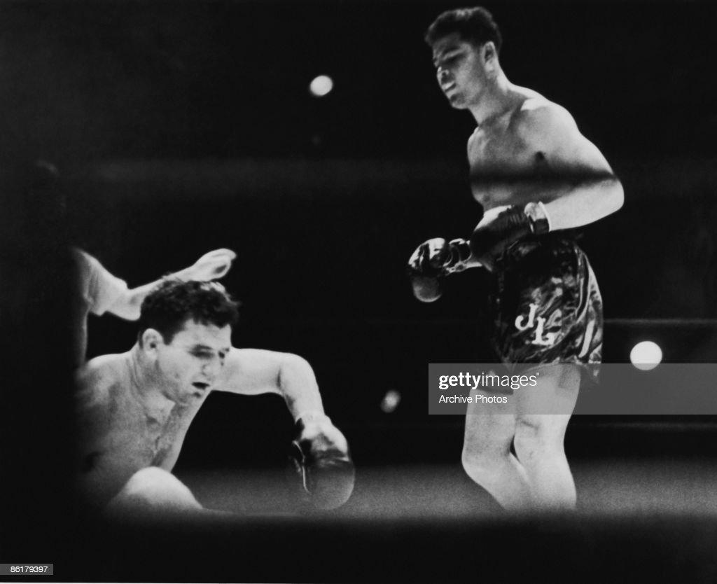 American boxer Joe Louis (1914 - 1981, right) defeats World Heavyweight champion James J. Braddock (1905 - 1974) in Chicago, 22nd June 1937.