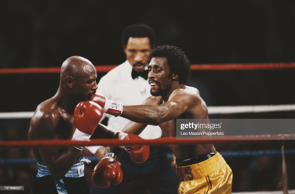 American boxer Marvelous Marvin Hagler, pictured left in dark shorts, in action against fellow American boxer Thomas Hearns, in yellow shorts, in a fight nicknamed 'The War' at Caesars Palace in Las Vegas, United States on 15th April 1985. Hagler would go on to win the fight by a knockout in the third round to retain his five middleweight titles. Referee Richard Steele keeps a close eye on the action.