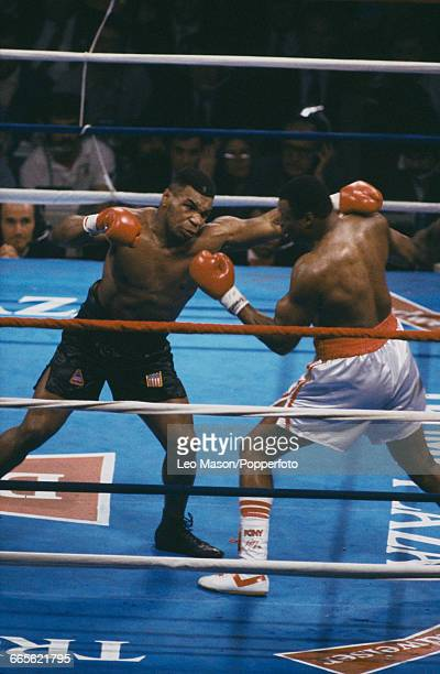 American boxer Mike Tyson pictured left in action during his fight against fellow American boxer Larry Holmes at the Convention Hall in Atlantic City...