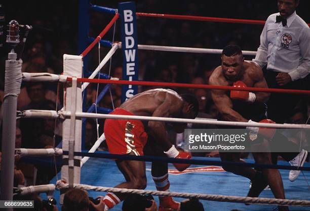 American boxer Mike Tyson pictured right in action against English boxer Frank Bruno at the Hilton Hotel in Las Vegas United States on 25th February...