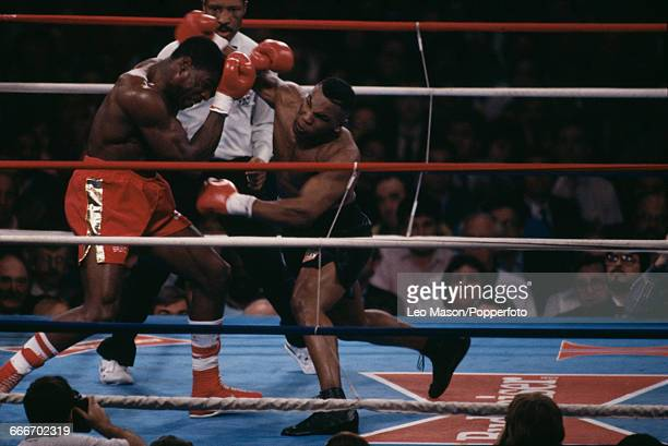 American boxer Mike Tyson pictured right in action against English boxer Frank Bruno during a fight at the Hilton Hotel in Las Vegas United States on...