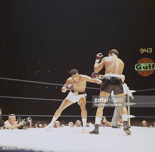 American boxer Muhammad Ali aims a left hander at challanger Cleveland Williams during the first round of a World heavyweight title fight in the...