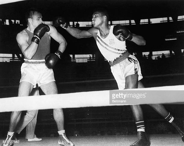 American boxer Muhammad Ali defeats Soviet boxer Gennady Schatkov to proceed to the next round at the 1960 Olympics in Rome.