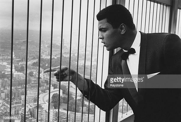 American boxer Muhammad Ali looks out over London from the top of the Post Office Tower 25th July 1966 Ali is in Britain to defend his World...