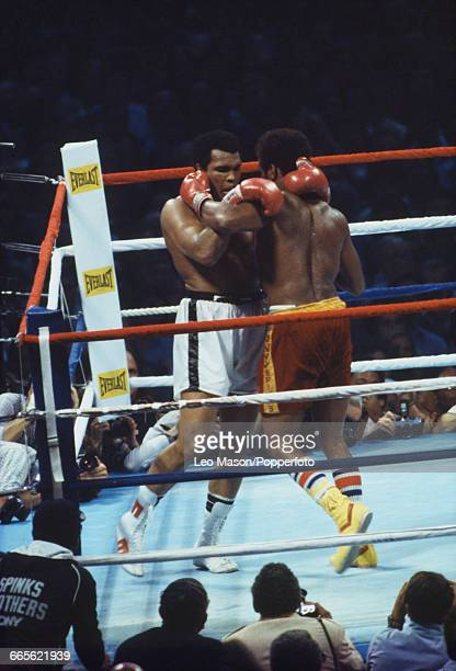 American boxer Muhammad Ali pictured left in white shorts in a clinch with fellow American boxer Leon Spinks in red shorts during their fight at the...
