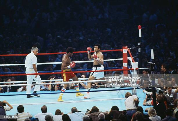 American boxer Muhammad Ali pictured right in white shorts in action against fellow American boxer Leon Spinks in red shorts at the Louisiana...