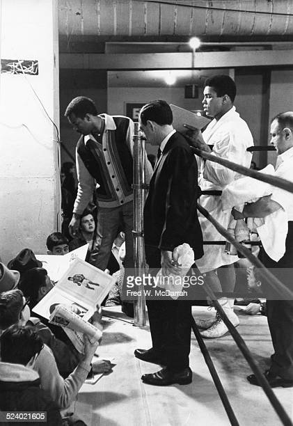 American boxer Muhammad Ali signs autographs from the ring after a training session New York New York March 16 1967