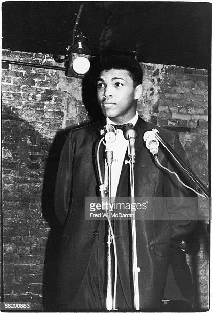 American boxer Muhammad Ali stands behind the microphone at the Bitter End Club where he and others participated in a poetry reading New York New...