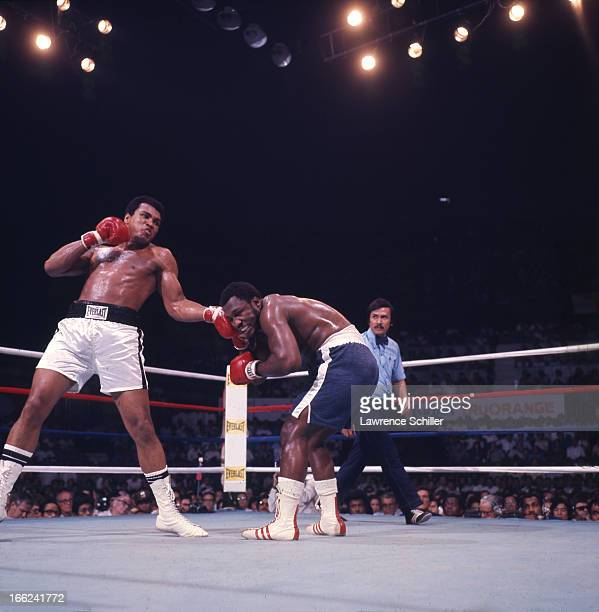American boxer Muhammad Ali throws a punch at Joe Frazier during their bout in the ring at Araneta Coliseum Quezon City Philippines October 1 1975...