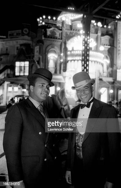 American boxer Muhammad Ali wears a bowler hat as he poses with actor James Earl Jones on the set of the film 'The Great White Hope' at 20th Century...