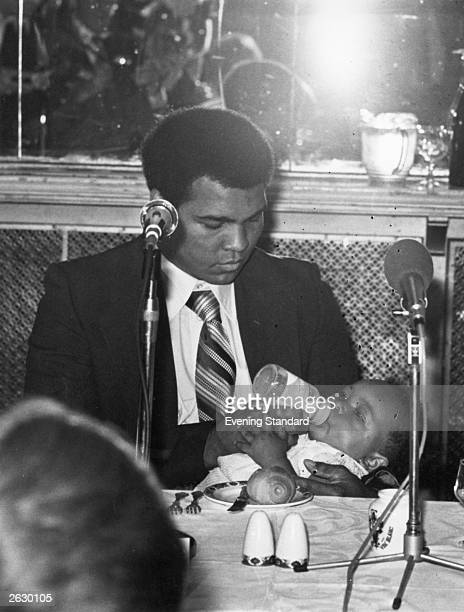 American boxer Muhammad Ali who first became world heavyweight champion in 1964 bottlefeeds his baby daughter Hana Ali has been left holding the baby...