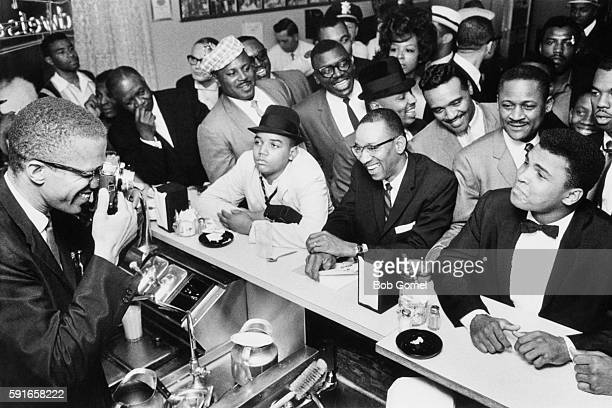 American boxer Muhammad Ali with African-American Muslim minister, public speaker, and human rights activist Malcolm X , after Ali beat Sonny Liston...