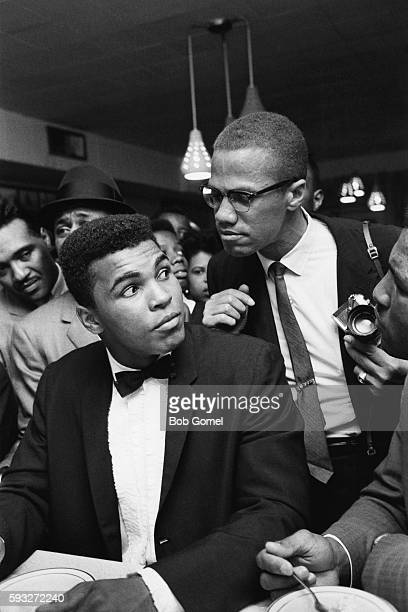 American boxer Muhammad Ali with AfricanAmerican Muslim minister public speaker and human rights activist Malcolm X after Ali beat Sonny Liston at...