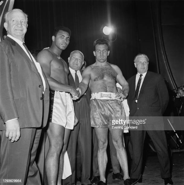 American boxer Muhammad Ali with British boxer Brian London during their weigh-in before the World Boxing Council World Heavyweight title fight in...