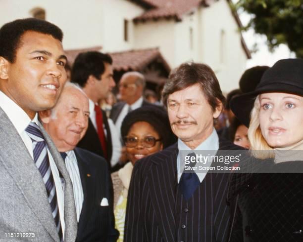 American boxer Muhammad Ali with married actors Charles Bronson and Jill Ireland circa 1976
