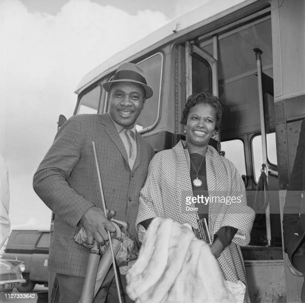 American boxer Sonny Liston with his wife Geraldine Chambers boarding a coach at Heathrow Airport London UK 31st August 1963