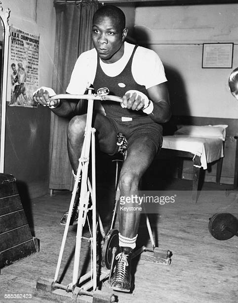 American boxer Sonny Ray working out on an exercise bike during training for his fight against Chic Calderwood at Wembley Stadium at Bloom's Gym in...